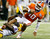 Bennie Logan #18 of the LSU Tigers tackles Tajh Boyd #10 of the Clemson Tigers during the 2012 Chick-fil-A Bowl at Georgia Dome on December 31, 2012 in Atlanta, Georgia.  (Photo by Kevin C. Cox/Getty Images)