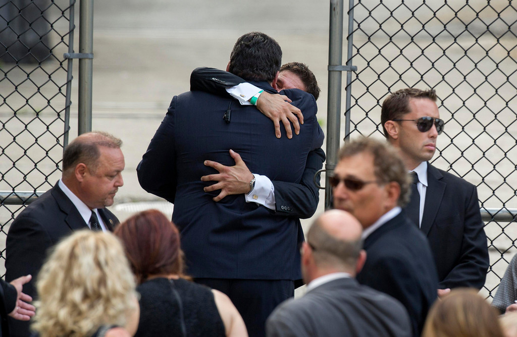 Description of . Mourners embrace outside the funeral services of James Gandolfini at the Cathedral Church of Saint John the Divine for funeral services in New York June 27, 2013. REUTERS/Lucas Jackson
