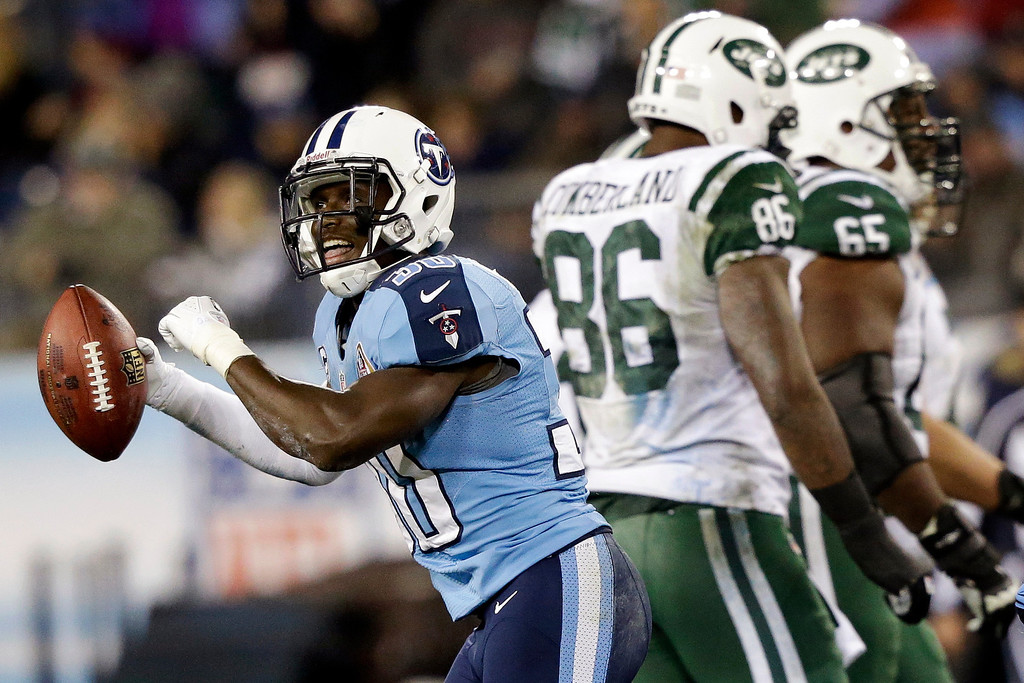Description of . Tennessee Titans cornerback Jason McCourty (30) celebrates after intercepting a pass from New York Jets quarterback Mark Sanchez, not shown, intended for tight end Jeff Cumberland (86) in the third quarter of an NFL football game, Monday, Dec. 17, 2012, in Nashville, Tenn. Jets' Brandon Moore (65) walks off the field. (AP Photo/Wade Payne)