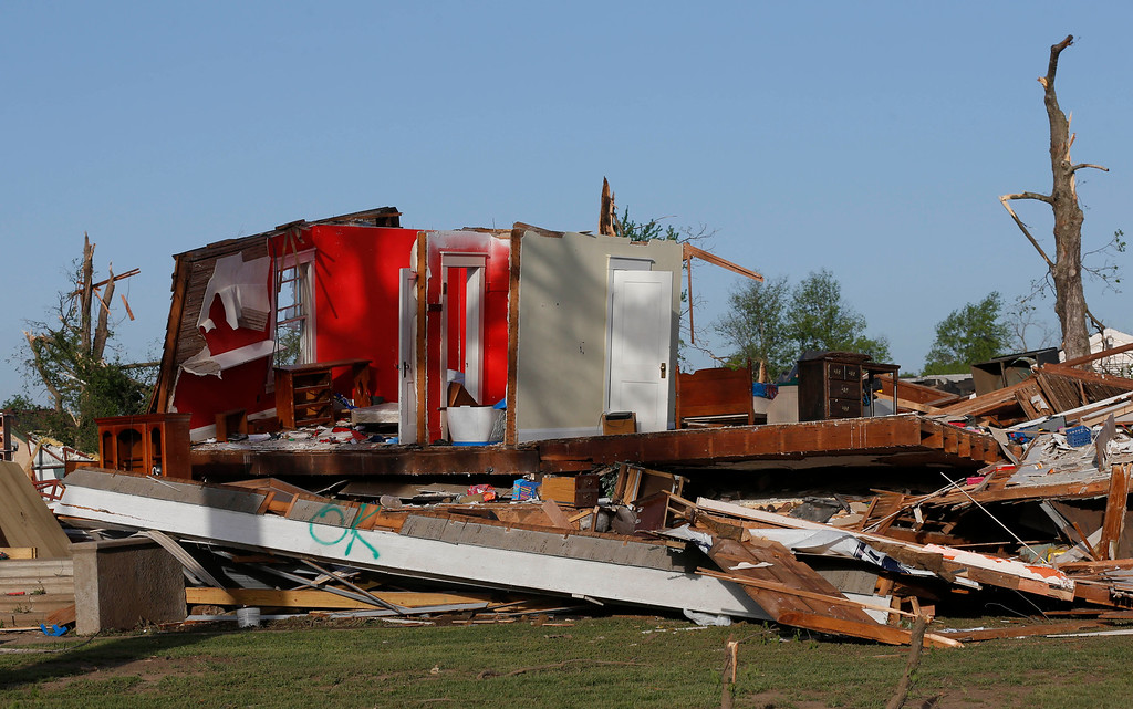 Description of . The remains of a home damaged by a tornado Sunday evening stands in Baxter Springs, Kan., Monday, April 28, 2014. The tornado left a trail of shattered homes, twisted metal and hanging power lines. (AP Photo/Orlin Wagner)