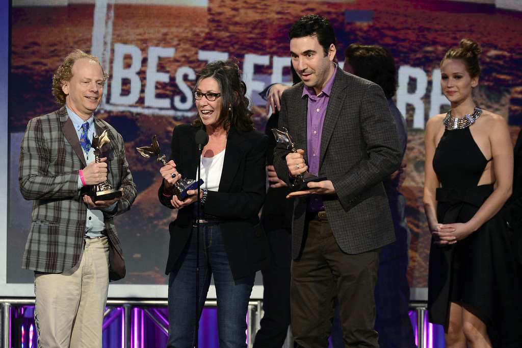 Description of . SANTA MONICA, CA - FEBRUARY 23:   (L-R) Producers Bruce Cohen, Donna Gigliotti and Jonathan Gordon and actress Jennifer Lawrence accept the Best Feature award for 'Silver Linings Playbook' onstage during the 2013 Film Independent Spirit Awards at Santa Monica Beach on February 23, 2013 in Santa Monica, California.  (Photo by Kevork Djansezian/Getty Images)