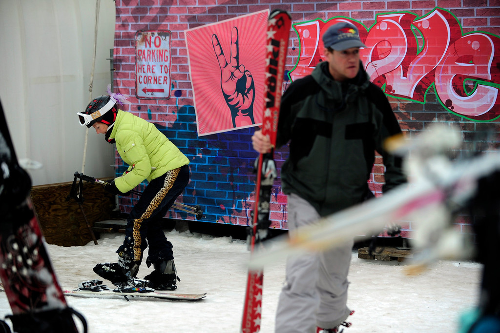 Description of . ASPEN, CO. - JANUARY 24:   Jan Hubbell, of Basalt, removes her skis after skiing on Buttermilk Mountain during the 2013 Aspen X Games on January 24, 2013