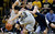 Colorado guard Sabatino Chen, left, scrambles after a loose ball next to California forward David Kravish during the first half of an NCAA college basketball game in Boulder, Colo., on Sunday, Jan. 27, 2013. (AP Photo/David Zalubowski)