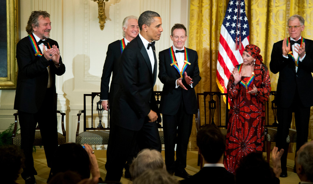 Description of . President Barack Obama is applauded by the 2012 Kennedy Center Honors recipients, from left, rock band Led Zeppelin singer Robert Plant, guitarist Jimmy Page, and keyboardist/bassist John Paul Jones, ballerina Natalia Makarova and comedian and television host David Letterman, at the conclusion of a reception hosted by President Barack Obama and first lady Michelle Obama for the honorees in the East Room of the White House in Washington, Sunday, Dec. 2, 2012.  While Led Zeppelin is being honored as a band, surviving members John Paul Jones, Jimmy Page, and Robert Plant, each received the Kennedy Center Honors. (AP Photo/Manuel Balce Ceneta)
