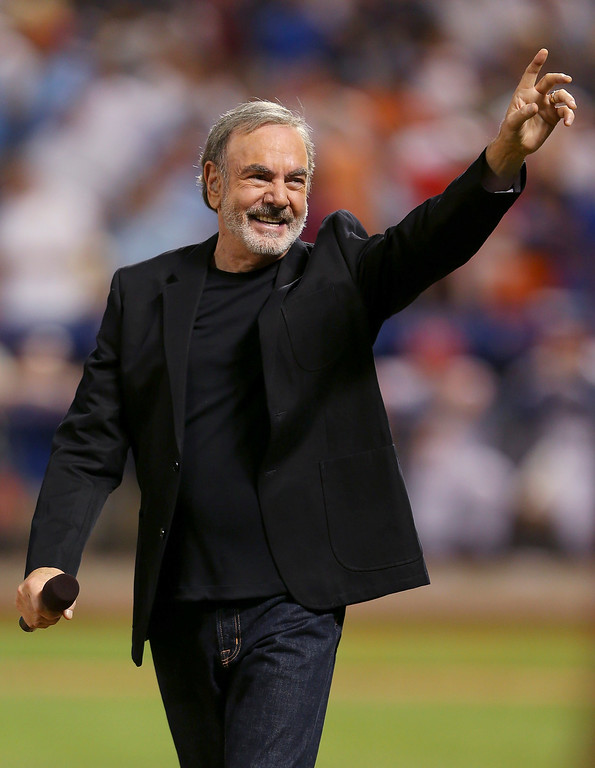 Description of . NEW YORK, NY - JULY 16:  Singer Neil Diamond performs during the 84th MLB All-Star Game on July 16, 2013 at Citi Field in the Flushing neighborhood of the Queens borough of New York City.  (Photo by Mike Ehrmann/Getty Images)