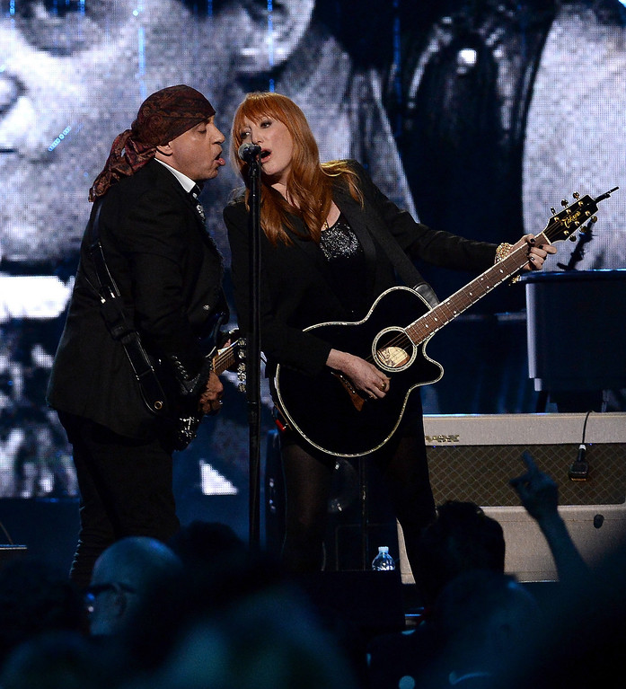 Description of . Inductees Steven Van Zandt (L) and Patti Scialfa of the E Street Band perform onstage at the 29th Annual Rock And Roll Hall Of Fame Induction Ceremony at Barclays Center of Brooklyn on April 10, 2014 in New York City.  (Photo by Larry Busacca/Getty Images)