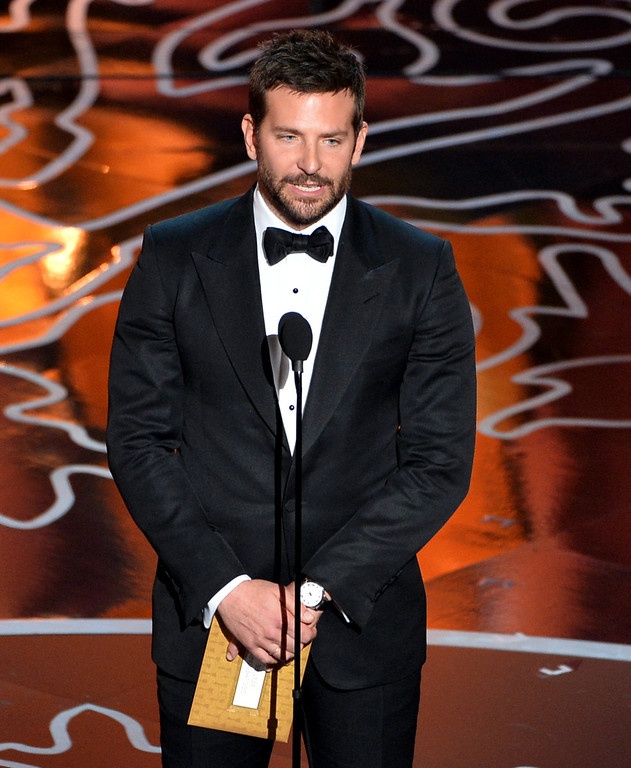 Description of . Actor Bradley Cooper speaks onstage during the Oscars at the Dolby Theatre on March 2, 2014 in Hollywood, California.  (Photo by Kevin Winter/Getty Images)