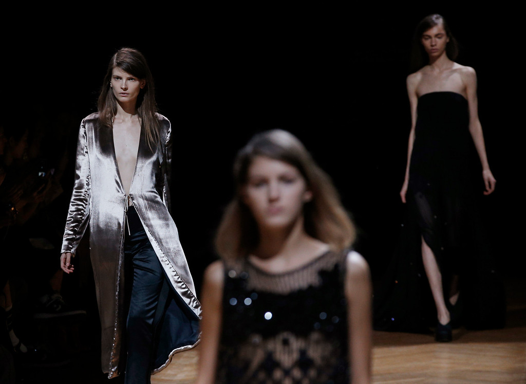 Description of . Models wear creatiosn for Irish fashion designer Sharon Wauchob's ready-to-wear Spring/Summer 2014 fashion collection, presented in Paris, Thursday, Sept.26, 2013. (AP Photo/Christophe Ena)
