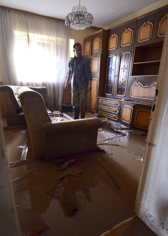 Description of . A man stands in the living room of his flooded house in Sveti Nikole, central Macedonia, Tuesday, Feb. 26, 2013. Three days of heavy rain have flooded hundreds of homes in eastern and central Macedonia, destroyed at least two bridges and cut off dozens of villages, causing power cuts and shortages of drinking water. (AP Photo/Boris Grdanoski)