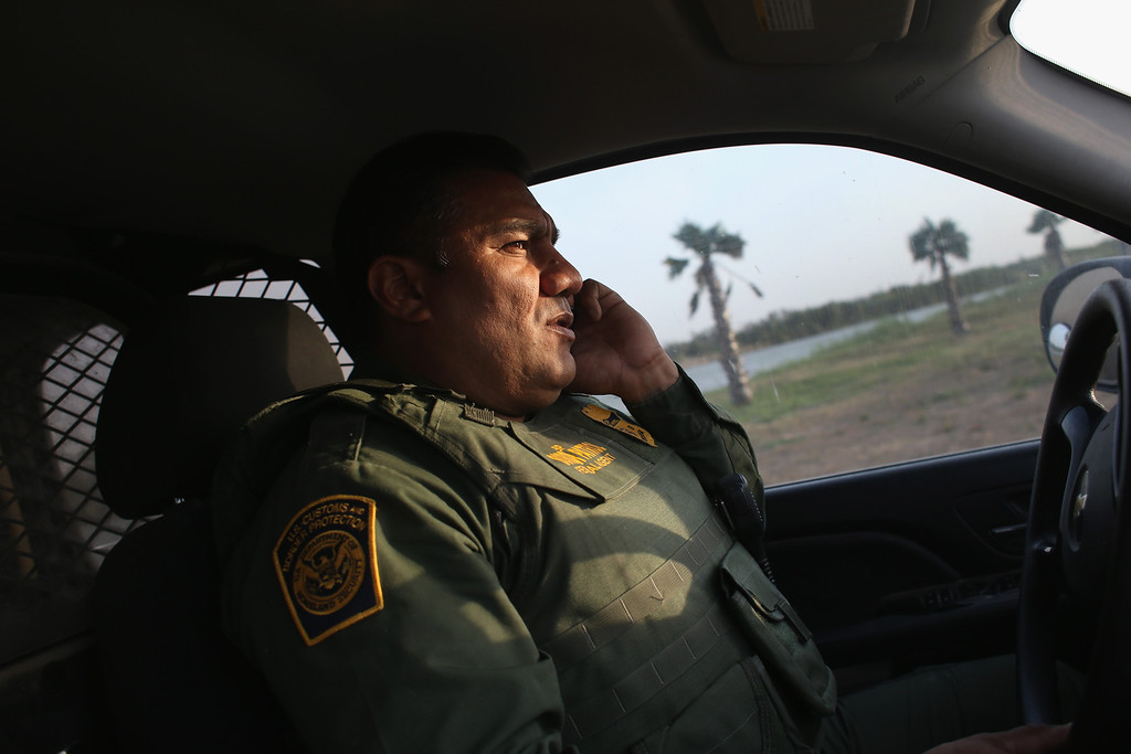 Description of . MCALLEN, TX - APRIL 10:  U.S. Border Patrol agent Sal De Leon patrols near the U.S.-Mexico border on April 10, 2013 in McAllen, Texas. According to the Border Patrol, undocumented immigrant crossings have increased more than 50 percent in Texas\' Rio Grande Valley sector in the last year. Border Patrol agents say they have also seen an additional surge in immigrant traffic since immigration reform negotiations began this year in Washington D.C. Proposed refoms could provide a path to citizenship for many of the estimated 11 million undocumented workers living in the United States.  (Photo by John Moore/Getty Images)
