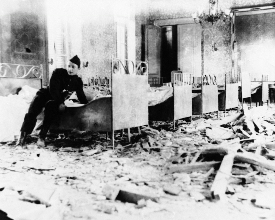Description of . State Room of the Cardinal of Malines in Belgium which had turned into a Red Cross ward, wrecked by an enemy shell during World War I in an undated photo. (AP Photo)