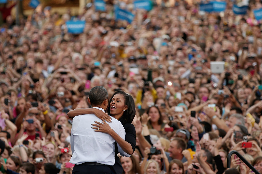 Description of . U.S. President Barack Obama and first lady Michelle Obama embrace during a campaign rally at the University of Iowa September 7, 2012 in Iowa City, Iowa. This is Obama and Biden's first day of campaigning after accepting the nomination for president yesterday at the Democratic National Convention in Charlotte, North Carolina.  (Photo by Chip Somodevilla/Getty Images)