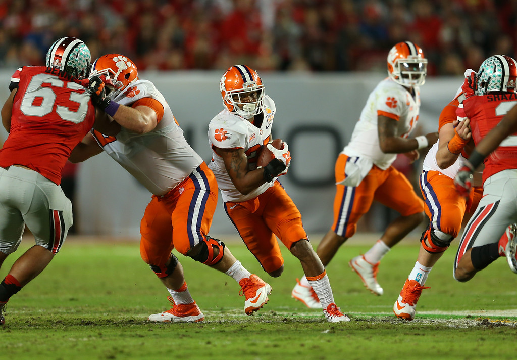 Description of . MIAMI GARDENS, FL - JANUARY 03: Roderick McDowell #25 of the Clemson Tigers runs with the ball against the Ohio State Buckeyes in the first half during the Discover Orange Bowl at Sun Life Stadium on January 3, 2014 in Miami Gardens, Florida.  (Photo by Mike Ehrmann/Getty Images)