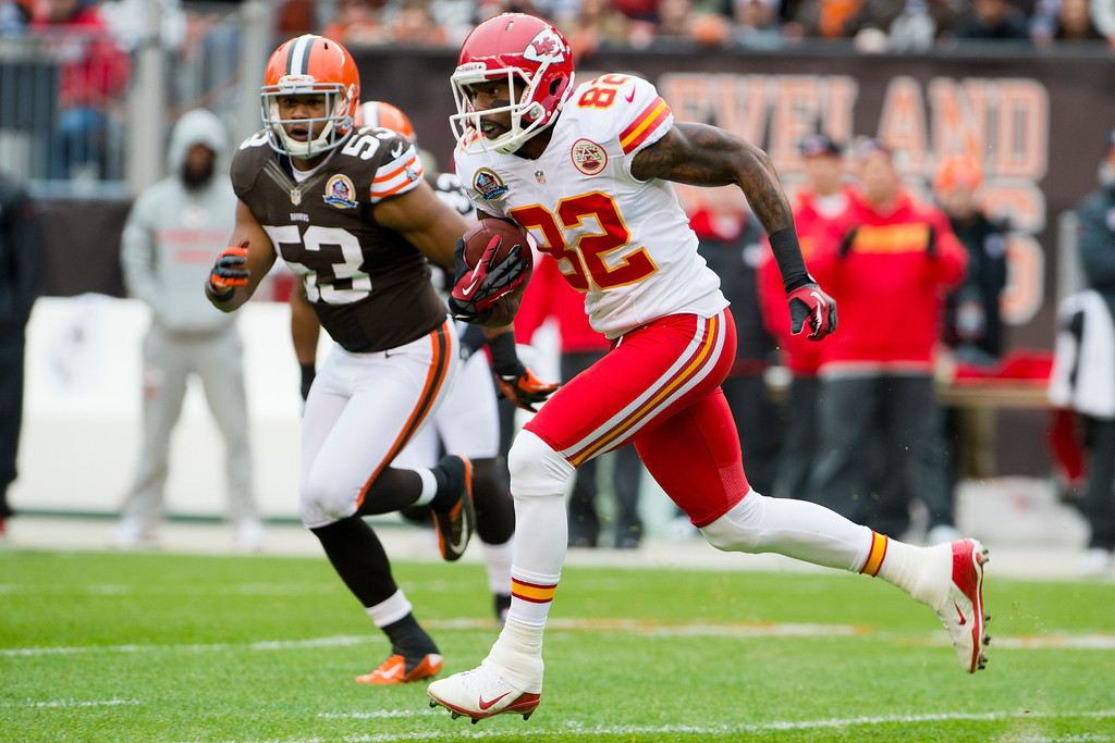 Description of . CLEVELAND, OH - DECEMBER 09: Linebacker Craig Robertson #53 of the Cleveland Browns tries to catch wide receiver Dwayne Bowe #82 of the Kansas City Chiefs during the first half at Cleveland Browns Stadium on December 9, 2012 in Cleveland, Ohio. (Photo by Jason Miller/Getty Images)