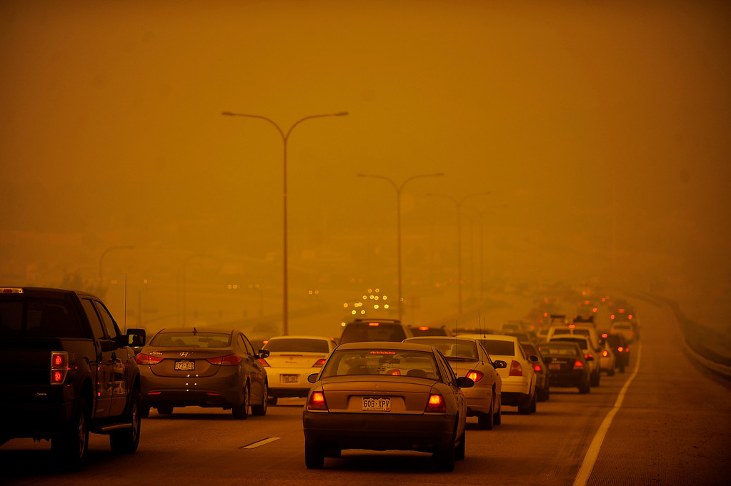Description of . The Waldo Canyon fire exploded on June 26th, 2012. A traffic jam of cars fleeing the city heading north on I-25 seemed enveloped by the orange haze of smoke. The Waldo Canyon fire burned northwest of Manitou Springs, Colorado. Helen H. Richardson, The Denver Post