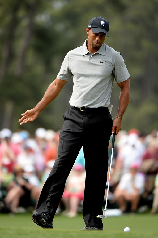 Description of . Tiger Woods of the United States reacts on the 17th hole during the first round of the 2013 Masters Tournament at Augusta National Golf Club on April 11, 2013 in Augusta, Georgia.  (Photo by Harry How/Getty Images)
