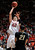 Utah center Jason Washburn (42) puts a shot over Colorado forward Andre Roberson (21) during the first half of an NCAA college basketball game Saturday, Feb. 2, 2013, in Salt Lake City. (AP Photo/Steve C. Wilson)