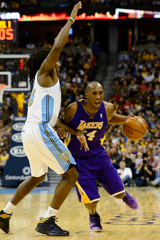 Description of . Los Angeles Lakers shooting guard Kobe Bryant (24) drives on Denver Nuggets center Timofey Mozgov (25) during the second half of the Nuggets' 126-114 win at the Pepsi Center on Wednesday, December 26, 2012. AAron Ontiveroz, The Denver Post
