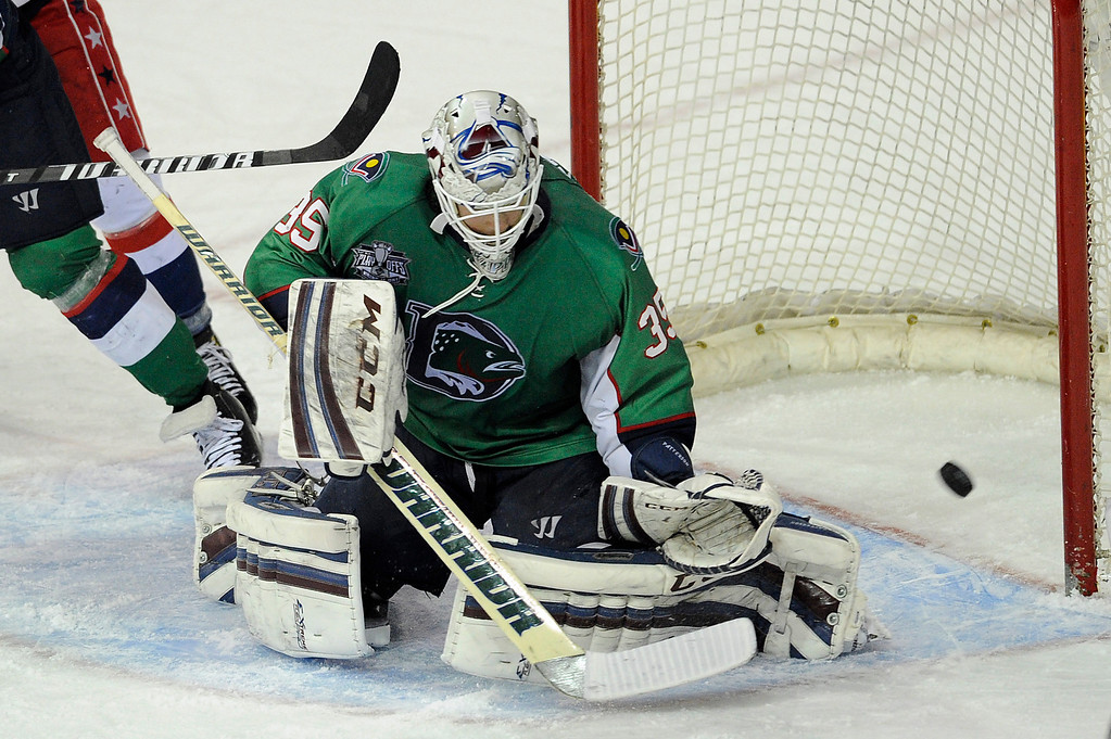 Description of . DENVER, CO - MAY 2: Denver Cutthroats goalie Kent Patterson (35) blocks a shot during the second period of game 1 of the Ray Miron Presidents Cup Finals at the Denver Coliseum in Denver, Colorado on May 2, 2014. (Photo by Seth McConnell/The Denver Post)