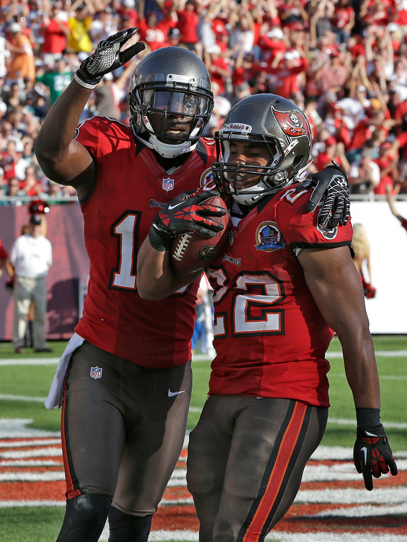 Description of . Tampa Bay Buccaneers running back Doug Martin (22) celebrates with teammate wide receiver Tiquan Underwood after scoring against the Philadelphia Eagles during the fourth quarter of an NFL football game Sunday, Dec. 9, 2012, in Tampa, Fla. (AP Photo/Chris O\'Meara)