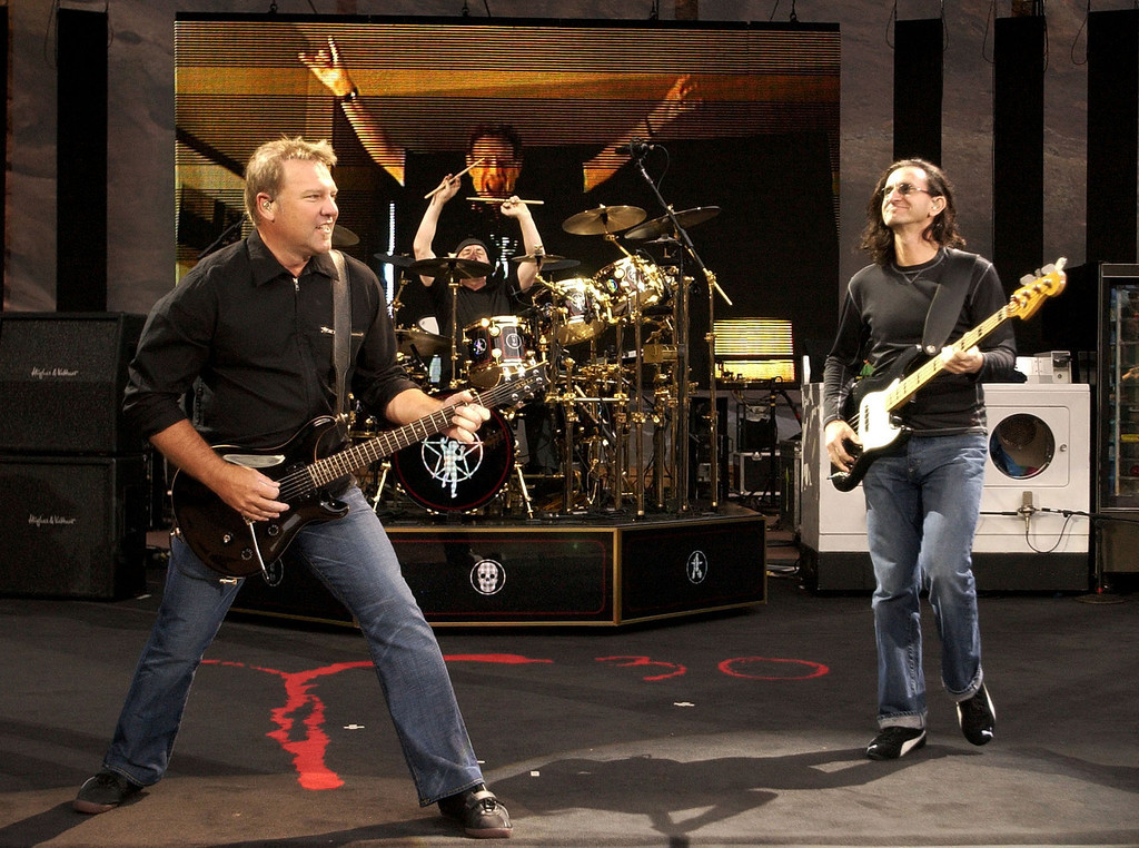 Description of . MORRISON, CO, JUNE 29, 2004 - Alex Lifeson (L) Neil Peart (M) and Geddy Lee (R) with the group Rush perform to a sold out crowd at Red Rocks during their 30th Anniversary Tour. This is the first time the band has performed at Red Rocks in it's history together. (DENVER POST PHOTO BY JOHN LEYBA)