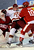 Denver wing Ty Loney (12) got pushed into Cornell goalie Andy Iles (33) by wing Madison Dias (10) in the first period. The University of Denver hockey team hosted Cornell at Magness Arena Saturday night, January 5, 2013. Karl Gehring/The Denver Post
