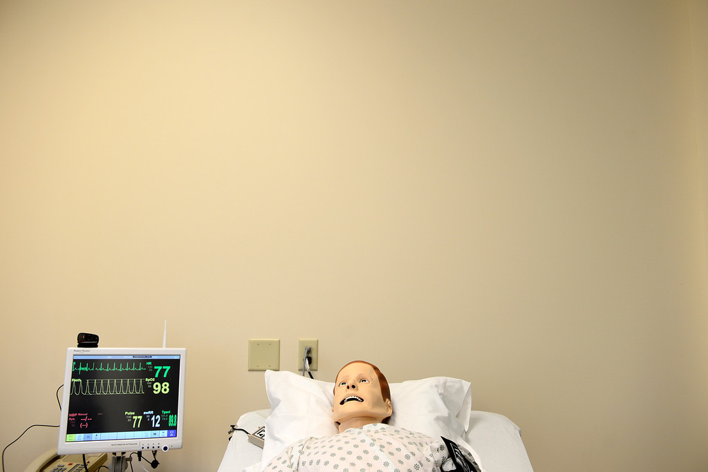 Description of . Sim Man, a high-tech simulation model, lies in a bed in the nursing school at the Emily Griffith Technical College on Thursday, December 6, 2012. AAron Ontiveroz, The Denver Post