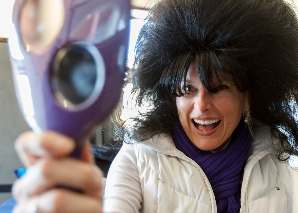 Description of . Karen Bobe checks her wig before posing in a Hairspray-themed photo on Park City's Main Street on the second day of the Sundance Film Festival Friday January 18, 2013. Trent Nelson  |  The Salt Lake Tribune