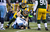 Clay Matthews #52 and Mike Neal #96 of the Green Bay Packers with a sack of Jake Locker #10 of the Tennessee Titans at Lambeau Field on December 23, 2012 in Green Bay, Wisconsin.  (Photo by Tom Lynn /Getty Images)