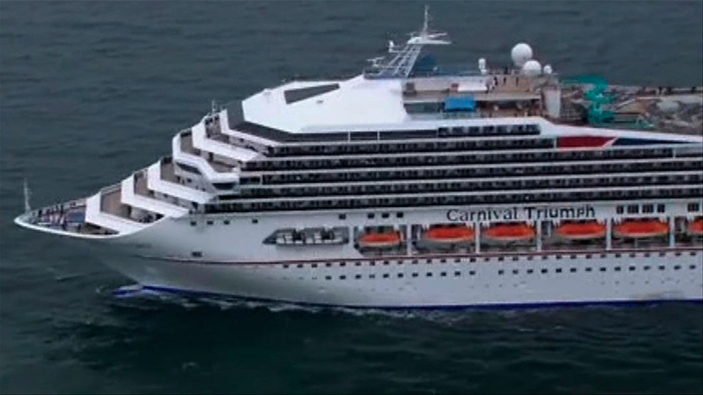 Description of . The cruise ship Carnival Triumph cruise ship is towed in this video frame grab from NBC News taken off the coast of Alabama, February 14, 2013. REUTERS/NBC News/Handout