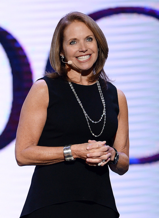 Description of . Journalist Katie Couric speaks during a keynote address by Yahoo! President and CEO Marissa Mayer at the 2014 International CES at The Las Vegas Hotel & Casino on January 7, 2014 in Las Vegas, Nevada. CES, the world's largest annual consumer technology trade show, runs through January 10 and is expected to feature 3,200 exhibitors showing off their latest products and services to about 150,000 attendees.  (Photo by Ethan Miller/Getty Images)