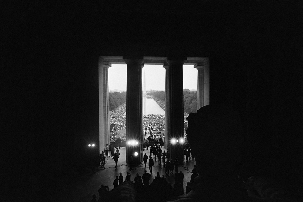 Description of . This is a view of the March on Washington crowd made from behind the statue of Abraham Lincoln in the Lincoln Memorial in Washington, August 28, 1963. In the distance is the Washington Monument and the Reflecting Pool. (AP Photo)