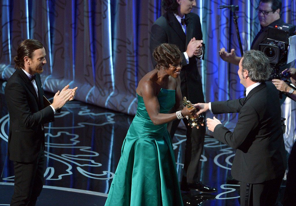 Description of . Presenters Ewan McGregor, left, and Viola Davis present Paolo Sorrentino with the award for best foreign language film of the year for ìThe Great Beautyî during the Oscars at the Dolby Theatre on Sunday, March 2, 2014, in Los Angeles.  (Photo by John Shearer/Invision/AP)