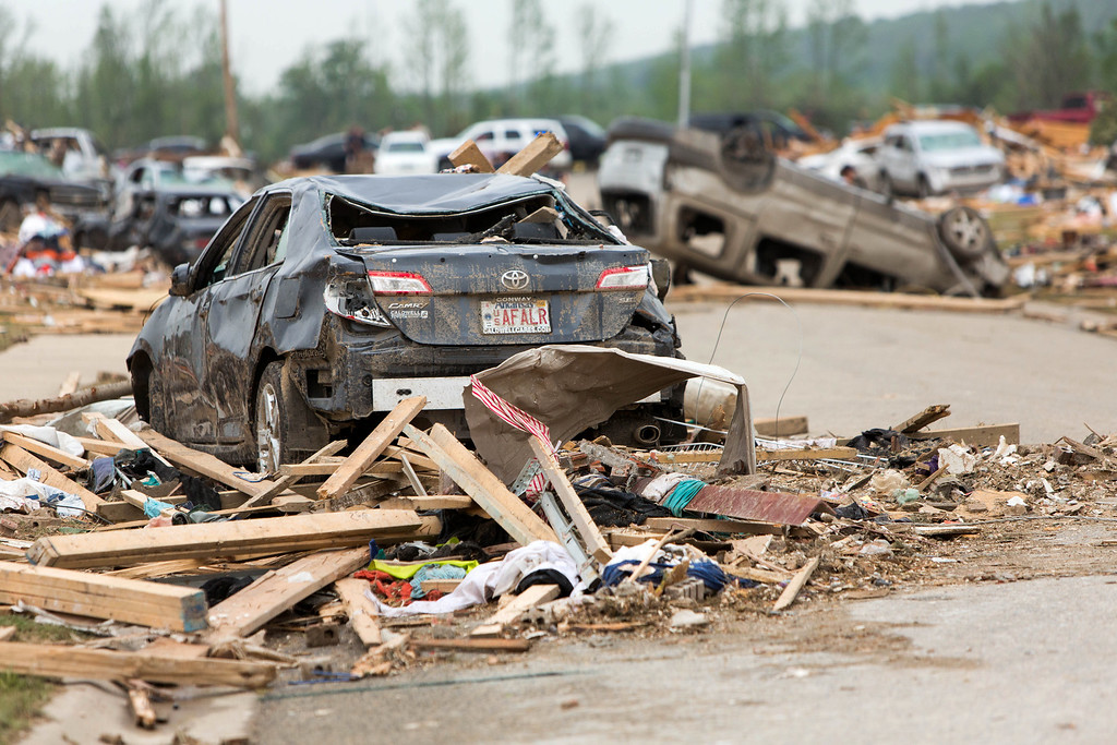 Description of . Piles of mangles cars and destroyed homes sit along Aspen Creek Drive in the Parkwood Neighborhood off Naylor Road in Vilonia, Ark., Monday, April 28, 2014 after a tornado struck the town late Sunday. (AP Photo/Karen E. Segrave)