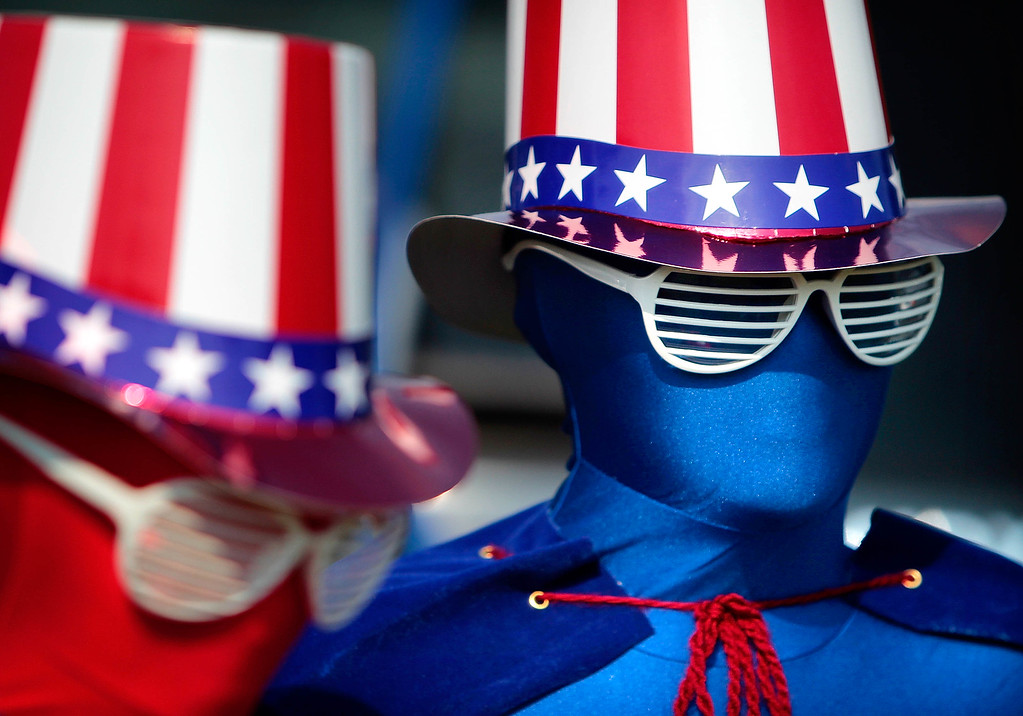 Description of . Decked out from head to toe in patriotism,  Remi Schaber (left), 9, and her brother Chase, 11, don spandex suits for the Cordova Independence Day Parade Thursday morning at the Cordova Community Center in Cordova, Tenn. Thursday, July 4, 2013.  (AP Photo/The Commercial Appeal, Jim Weber)
