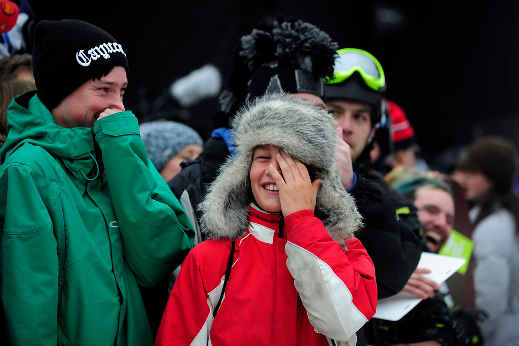 Description of . ASPEN, CO. - JANUARY 24:   Kids laugh as ESPN commentators goad the crowd into getting excited to be on live TV at the 2013 Aspen X Games on Buttermilk Mountain. (Photo By Mahala Gaylord / The Denver Post)