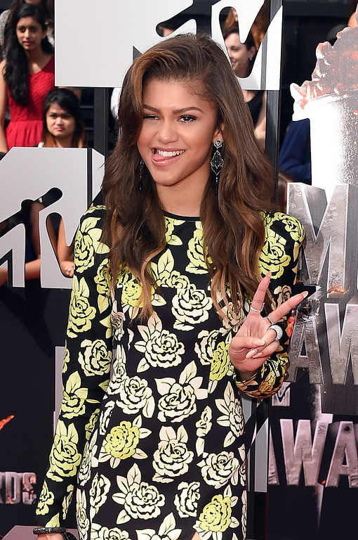Description of . Actress Zendaya attends the 2014 MTV Movie Awards at Nokia Theatre L.A. Live on April 13, 2014 in Los Angeles, California.  (Photo by Jason Merritt/Getty Images for MTV)