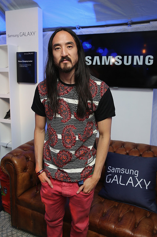 Description of . CHICAGO, IL - AUGUST 02:  Steve Aoki attends the Samsung Galaxy Artist Lounge at Lollapalooza  on August 2, 2013 in Chicago City.  (Photo by Neilson Barnard/Getty Images for Samsung Galaxy)