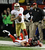 San Francisco 49ers' Colin Kaepernick runs past Atlanta Falcons' Kroy Biermann during the first half of the NFL football NFC Championship game Sunday, Jan. 20, 2013, in Atlanta. (AP Photo/Dave Martin)
