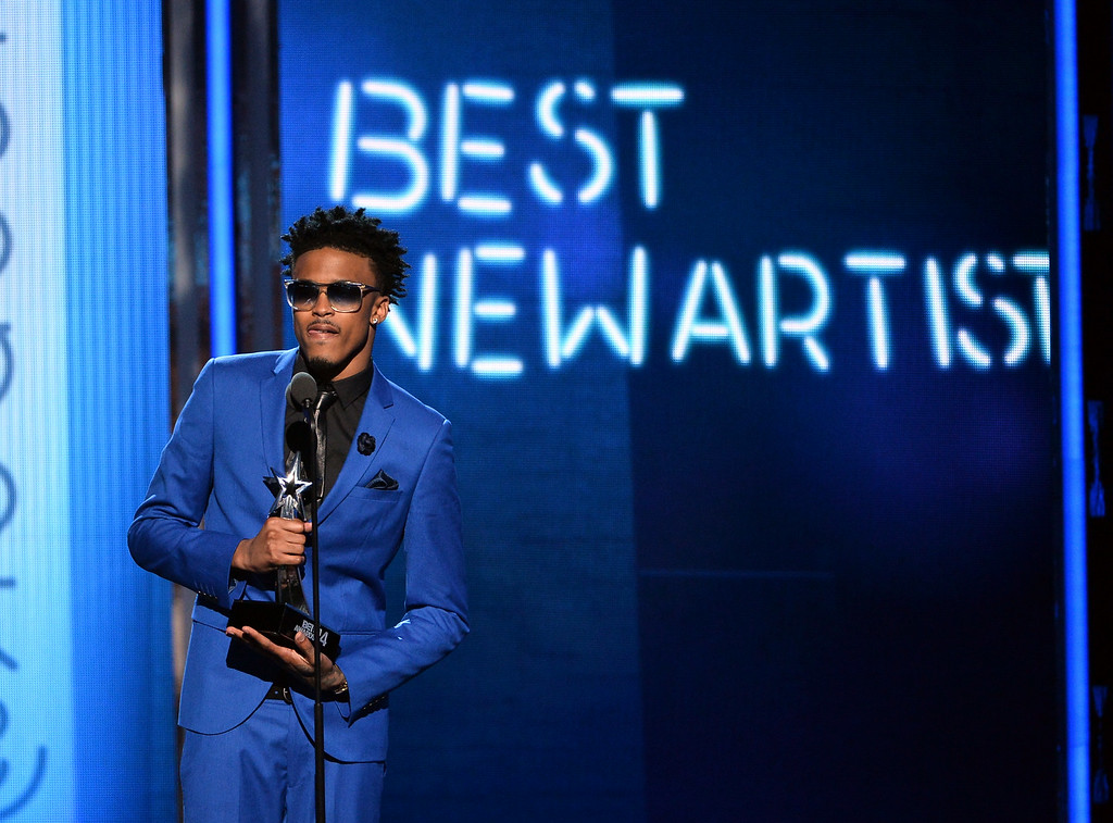 Description of . Singer August Alsina accepts Best New Artist onstage during the BET AWARDS '14 at Nokia Theatre L.A. LIVE on June 29, 2014 in Los Angeles, California.  (Photo by Kevin Winter/Getty Images for BET)