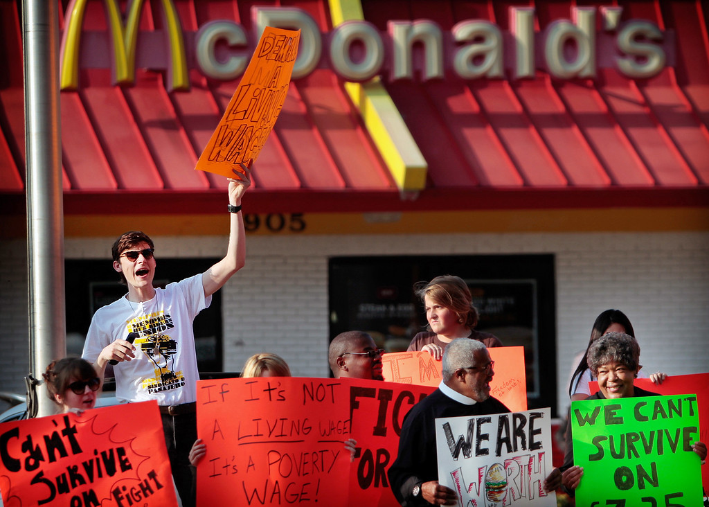 Description of . Bennett Foster, left, joins a crowd of some low-income fast food workers and their supporters in protest on Thursday, Aug. 29, 2013, while picketing outside of the McDonalds restaurant in Memphis, Tenn. (AP Photo/The Commercial Appeal, Jim Weber)