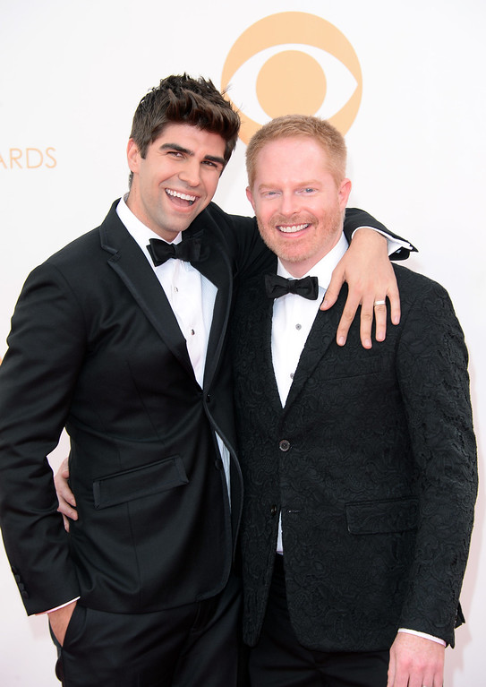 Description of . Actor Jesse Tyler Ferguson (R) and attorney Justin Mikita arrive at the 65th Annual Primetime Emmy Awards held at Nokia Theatre L.A. Live on September 22, 2013 in Los Angeles, California.  (Photo by Jason Merritt/Getty Images)