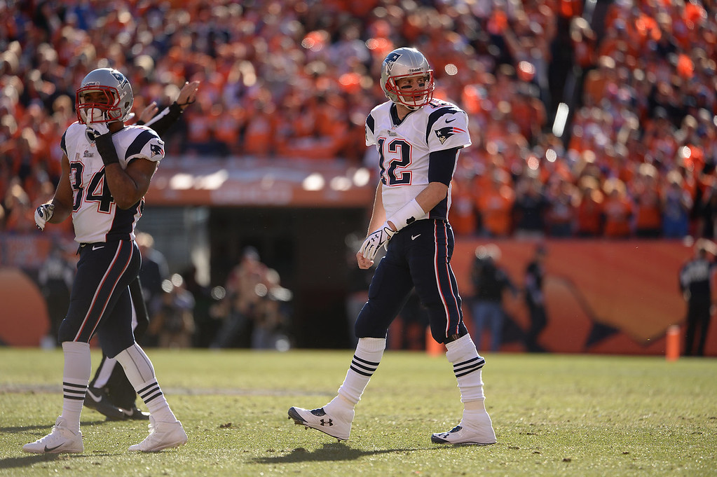 Description of . New England Patriots quarterback Tom Brady (12) in the second quarter. The Denver Broncos take on the New England Patriots in the AFC Championship game at Sports Authority Field at Mile High in Denver on January 19, 2014. (Photo by Hyoung Chang/The Denver Post)