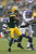 Alex Green #20 of the Green Bay Packers is tackled by Jasper Brinkley #54 of the Minnesota Vikings at Lambeau Field on December 2, 2012 in Green Bay, Wisconsin.  The Packers defeated the Vikings 23-14.  (Photo by Wesley Hitt/Getty Images)