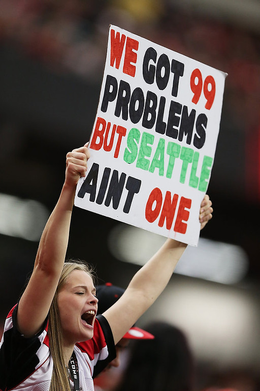 Description of . An Atlanta Falcons fan holds up a sign at the start of their NFC Divisional Playoff Game against the Seattle Seahawks at Georgia Dome on January 13, 2013 in Atlanta, Georgia.  (Photo by Streeter Lecka/Getty Images)