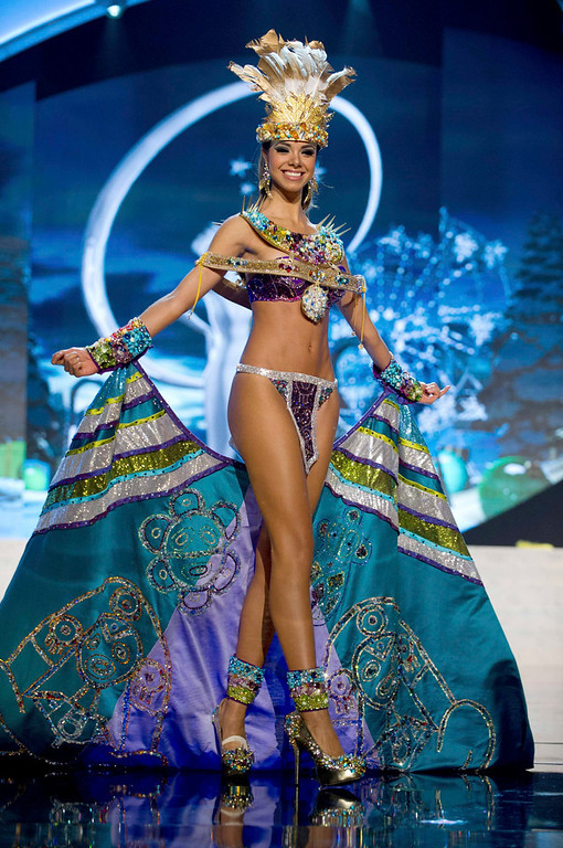 Description of . Miss Puerto Rico Bodine Koehler performs onstage at the 2012 Miss Universe National Costume Show at PH Live in Las Vegas, Nevada December 14, 2012. The 89 Miss Universe Contestants will compete for the Diamond Nexus Crown on December 19, 2012. REUTERS/Darren Decker/Miss Universe Organization/Handout