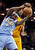 Denver Nuggets' Ty Lawson (3) challenges Cleveland Cavaliers' Tristan Thompson for a rebound in the fourth quarter of an NBA basketball game Saturday, Feb. 9, 2013, in Cleveland. Denver won 111-103. (AP Photo/Mark Duncan)