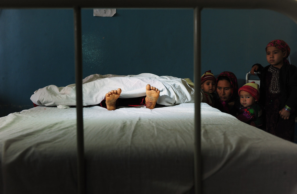Description of . The family of a five year old Afghan girl, that was allegedly raped by a 22 year old man, looks on as she lies in a hospital bed in Kaldar district of Balk Province of Mazar-i-Sharif on November 12, 2012. The alleged rapist and neighbor was later detained by police. There is little sign that violence against women in Afghanistan is decreasing, despite billions of dollars of international aid which has poured into the country during the decade-long war.  Some 87 percent of Afghan women report having experienced physical, sexual or psychological violence or forced marriage, according to figures quoted in an October report by the British charity Oxfam. (QAIS USYAN/AFP/Getty Images)