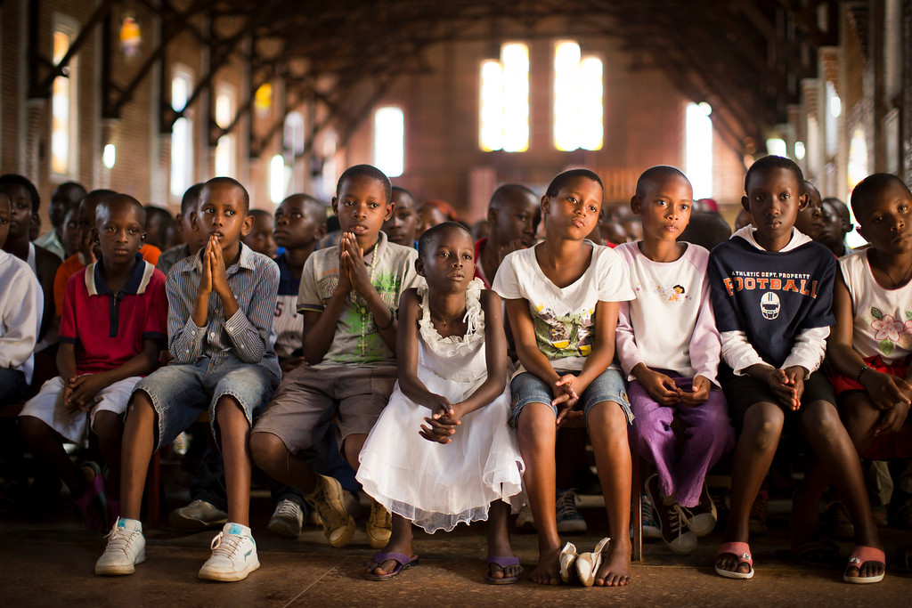 . Rwandan children listen and pray during a Sunday morning service at the Saint-Famille Catholic church, the scene of many killings during the 1994 genocide, in the capital Kigali, Rwanda Sunday, April 6, 2014. Rwanda will commemorate on Monday the 20-year anniversary of the genocide when ethnic Hutu extremists killed neighbors, friends and family during a three-month rampage of violence aimed at ethnic Tutsis and some moderate Hutus, leaving a death toll that Rwanda puts at 1,000,050. (AP Photo/Ben Curtis)