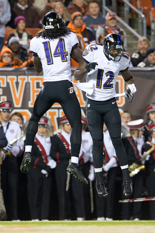 . Wide receiver Marlon Brown #14 celebrates with wide receiver Jacoby Jones #12 of the Baltimore Ravens after Brown scored a touchdown during the first half against the Cleveland Browns at FirstEnergy Stadium on November 3, 2013 in Cleveland, Ohio. (Photo by Jason Miller/Getty Images)